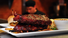 Double smoked baby back ribs grilled to order with our signature BBQ sauce.